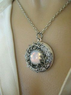 Sterling silver filigree locket pendant with moonstone cabochon