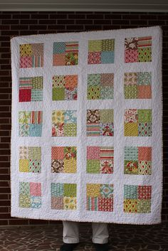 Simple charm block quilt by Frecklemama, uses 2 packs.