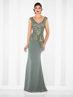 Chiffon fit and flare gown with lace illusion cap sleeves, front and back lace illusion V-necklines, scalloped lace sweetheart bodice with asymmetrically draped peplum and side ruffle. Matching shawl included. Sizes: 4 – 20 Colors: Steel Gray, Butterscotch, Navy Blue