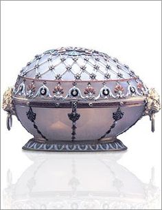 Renaissance Egg, one of the Nine Imperial Eggs (1894). This egg is decorated with gold, white agate, enamel, diamonds, and rubies. It is unknown what the treasure was inside the egg as its whereabouts remain unknown