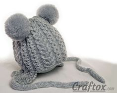 Knitting winter hat with pom poms for child