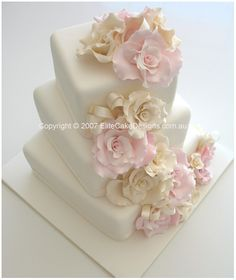 Ivory & Pink Roses   Wedding Cake  An elegant wedding cake design with ivory & pink roses and ribbon in between.  Rose & ribbon colour can be varied to match your event colour scheme.    Price $700
