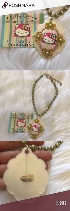 Tarina Tarantino Hello Kitty Pink Head Necklace Tarina Tarantino Hello Kitty Pink Head Collection.  Cameo and green pearl necklace with adjustable clasp.  Hook closure that can be made smaller or larger.  Cameo has flowers, crystals, and pearls.  New necklace, authentic.  Purchased from Bloomingdales when first released.  RARE!  No longer produced.  Comes with card.  Signed plate on back. Tarina Tarantino Jewelry Necklaces