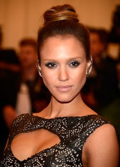 Jessica Alba channeled her inner punk with a leather gown and striking earrings for the Met Gala!