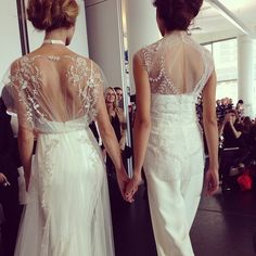 Hand in hand at Rivini. Gorgeous gown & bridal jumpsuit combo! #bridalmarket