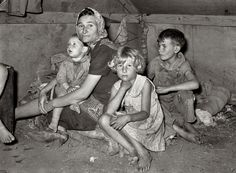 1939 - Mother with children at migrant camp. Welasco, Texas. Photo by Russell Lee