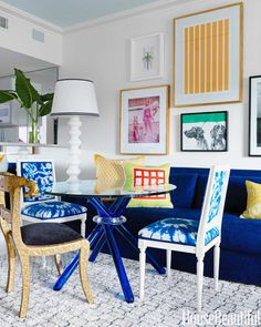 """The blue of the Mediterranean, and the tops of the churches in Santorini—or Papers and Paints' TC32. It's so rich and fabulous, perfect when paired with a grey or pink"" -Sara Story As seen here in the dining area of designer Robert Passal's Miami Beach apartment.   - HouseBeautiful.com"