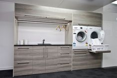 Love the slide out shelf Ezy Kitchens showroom Invercargill - contemporary - Laundry Room - Other Metro - Hamish Ballantyne