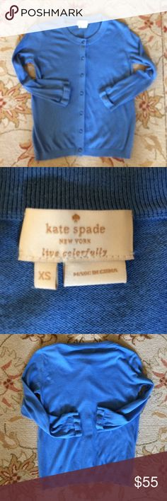 "🎀 Kate Spade New York Blue Cardigan Misses Sz XS! So pretty! Authentic ""Kate Spade New York"" Light Blue Silk Cardigan Sweater in Misses Size XS. Beautiful signature bows on ends of sleeves. Unique buttons (7) down front. 70% Silk, 30% Cotton. In nice, pre-owned condition with many more miles of wear left (no holes, tips, etc.). Wear Year-round. Bust measures approx. 34-36 inches, sleeve length is 19 inches, and total length is 23 inches. Perfect to wear at church, school, work, parties…"