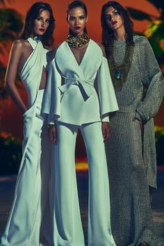 The look on the left.  I dig that agate necklace/choker and that hater top with pockets. - Balmain Resort 2017 collection.
