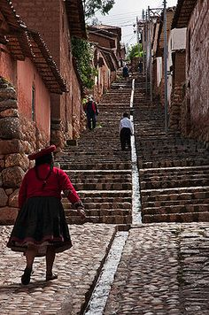 One of the steep stone pedestrian streets at Chinchero, an attractive Andean market town built on a hillside. Sacred Valley, Peru