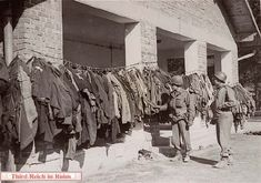 (Picture from Arnold Bauer Barach Collection, courtesy of USHMM Photo Archives.) Two American soldiers examine disinfected prisoner uniforms in Dachau. (April 29 - May Ww2 Pictures, Political Prisoners, Lest We Forget, Historical Images, American Soldiers, World War Two, Wwii, Germany, Death