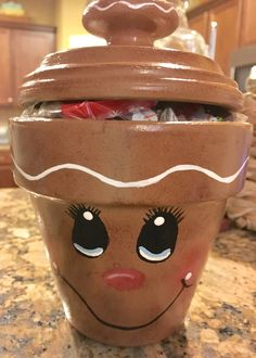 Gingerbread painted clay pot with clay saucer lid and glued wooden knob . Christmas Clay, Homemade Christmas, Diy Christmas Gifts, Christmas Projects, Christmas Decorations, Clay Pot Projects, Clay Pot Crafts, Paper Crafts, Cardboard Crafts