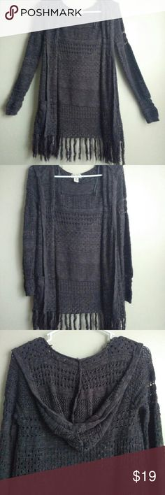 Grey Holed Cardigan with Hood Medium long dark grey cardigan. Long, fitted sleeves with a hood. String fringes at the bottom. Adds a warm touch to any outfit!  Lightly Worn. Mudd Sweaters Cardigans