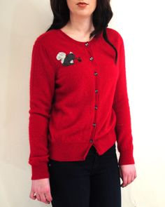 The adorable black squirrel patch on this beautiful bold red #cashmere cardigan is perfect for a fun carefree look!
