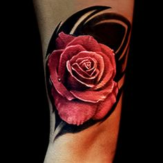 Realistic red rose tattoo done by Brandon Marques. Timeless Tattoo Studio, Toronto, ON. For appointments and info visit our website or email: info@timelesstattoos.ca.