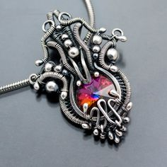 Swarovski Crystal Pendant  Fine Silver Wire Weave   By Sarah n Dippity
