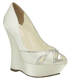 "Ivory Pink Cherish Bridal Shoes $100.00 The Cherish by Pink is the bridal wedge updated for the modern bride. The beautiful cross over rope design at the toe is accented with rhinestones. The 4 1/4"" heel is balance in the front with a 1"" platform for easy walking and balance. Available in dyeable White and Ivory. http://www.bellissimabridalshoes.com/Ivory-Pink-Cherish-Bridal-Shoes-Prodview.html"