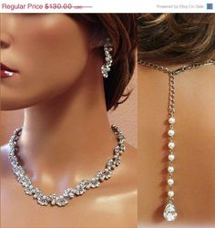 Bridal jewelry set, Bridal back drop bib necklace and earrings, vintage inspired crystal, pearl bridal statement, bridesmaid jewelry set. $91.00, via Etsy.