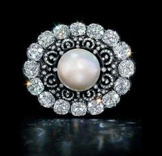 Don't you think that every woman should own pearls?  The Putilov #pearl and #diamond #brooch C1900 - Largest known near-round natural saltwater pearl - sold at a Rago Arts auction @ragoauctions in 2014 for $813,750. The piece was probably once part of the Russian crown jewels according to their catalog.