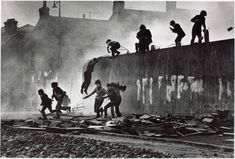 Don McCullin Catholic youth escaping a CS gas assault in the Bogside, Derry, Northern Ireland, 1971.