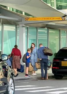 Prince William appeared to put his grandmother's health scare behind him and carried on as normal this week as he was spotted outside the Windsor Suite at Heathrow airport along with his wife