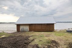 """Snøhetta has revived an old wooden boathouse on a Norwegian island to create a dormitory for children visiting an annual summer camp. """"The panelling is placed so that the building opens up for the morning sun, then closes and creates shadow at noon and the hottest part of the day, then opens up for the sunset again,"""" Løddesøl told Dezeen."""