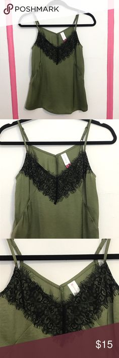 Olive Satin Slip Top Lace V Neck tank sexy cute Olive green sexy yet Chic slip top with black lace neck appliqué. Poly Satin fabric & adjustable spaghetti straps. Brand new condition and never worn. Brand is No Boundaries and is a juniors size Small. Wear this top out to a date, Friday night out with the girls to a club or bar hop or wear for cute leisure fashion. Not from Necessary Clothing, just tagged for exposure. Make reasonable offers on any item in my closet & bundle 2 items or more…