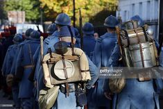 Performers wearing WWI French Army 'Poilus' military uniforms take part in a reenactment of WWI in Claye-Souilly, some 38 kilometers northeast of Paris, on November 11, 2014 as part of Armistice Day commemoration ceremonies marking the 96th anniversary of the end of World War I.