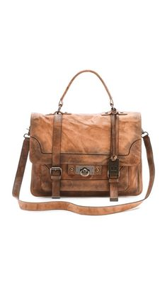 Frye Cameron Satchel, $500. An abundance of pockets and an adjustable profile lend easy versatility to a mottled leather bag with a rich, time-worn patina.