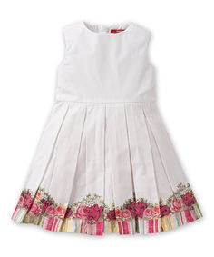 Whether strolling down the Amstel river or frolicking through the tulips, this frock will keep loves comfy with its flowy construction. Its vibrantly printed A-line silhouette zips up the back, so little ones won't miss a moment of exploration.