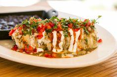 Stuffed w/scrambled eggs, chicken chorizo, peppers & more delicious! - Sunrise Fiesta Burrito