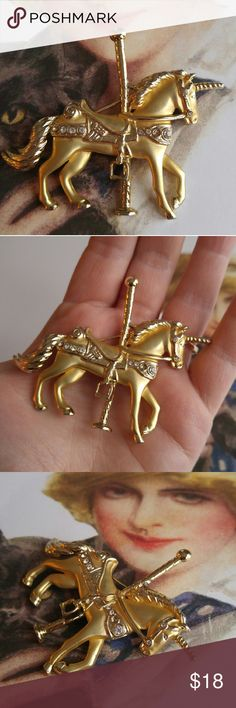 Vintage carousel unicorn brooch! Gold tone This beautiful carousel unicorn brooch is made of high quality gold tone metal. There are several sparkly clear diamante stones set in.  This pin is in great shape with very minor surface wear. From a smoke free home :)  FawnF8488uni888 Vintage Jewelry Brooches