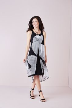 An abstract geometric print compliments a split sheath overlay with a classically styled sleeveless silhouette, finished with a flowy handkerchief hem you'll love. Summer Office, Office Essentials, Overlays, Compliments, Work Wear, Silhouette, Chic, How To Wear, Black