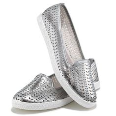 Get on the cutting edge of fashion in these lightweight and comfortable slip-on sneakers. Features a perforated/laser-cut leatherlike upper with silver trim and white trim on the sole. Whole sizes only. Half sizes, order one size up.· Upper: Laser cut silver Polyurethane· Upper lining: Faux suede· Sock: Gray canvas· Ousole: White Thermal Plastic Rubber· Cleaning: Wipe with a dry cloth· ImportedWhile Supplies Last