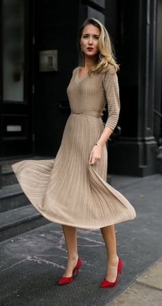 a nude dress mixed with red heels