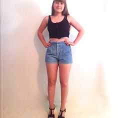 """80s Jean Denim Shorts High Waist Pockets S M 6 7 Adorable 80s denim shorts.  They have a high wide waistline, cute squared front pockets with a zip and button closure and attached belt.   Material: Cotton  Color: Light denim Maker: Fancy That Origin: Hong Kong  Era: 80's  Size: S M 6/7 judging by measurements and fit  Measurements:  Waist- 28""""  Length- 2"""" inseam Hips- 40""""  Model is a size 6/7   Condition: good condition, no flaws found Vintage Shorts Jean Shorts"""