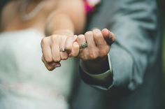 the bride + groom with their new wedding bands | see more of this stunning affair here: http://www.mywedding.com/articles/tyler-and-janelles-romantic-gibsonburg-oh-wedding-by-gage-blake-photography/