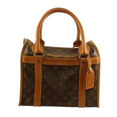 Vintage Louis Vuitton Monogram Train Case   From a collection of rare vintage handbags and purses at https://www.1stdibs.com/fashion/accessories/handbags-purses/