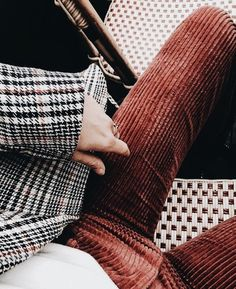 Rust corduroy pants with checked blazer and white tee.