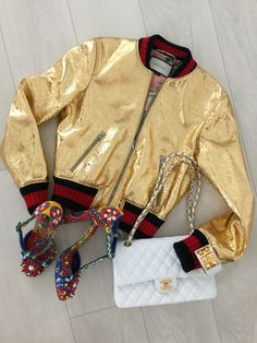 Gucci gold crackle leather bomber jacket, Chanel classic flap, Hermes Collier de Chien bracelet, Dolce and Gabbana T-strap shoes