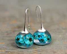 Real blossom earrings. Turquoise real flowers in resin spheres. Silver ox earwires. Big earrings. Gift for her. by VillaSorgenfrei on Etsy https://www.etsy.com/listing/277330574/real-blossom-earrings-turquoise-real
