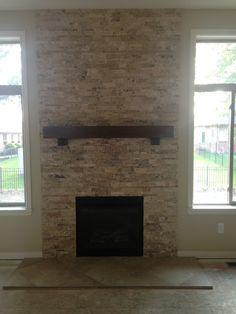 Travertine stacked stone fireplace