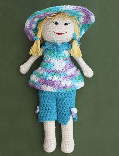 With removable accessories, Lily is ready to plant her spring garden! (Yarnspirations)