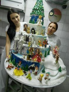 Disney Princesses. Cake. I must find this cake an then I must find a glass freezer to keep this cake in.