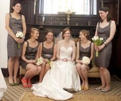 love the bridesmaids bouquets- each a different type of white flower