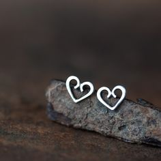 "Minimalist cute silver heart stud earrings. Romantic, sentimental, and a timeless symbol of love :) - Earrings will be shipped with sterling silver ""butterfly"" clutch - Heart shapes measure approx 6 x"