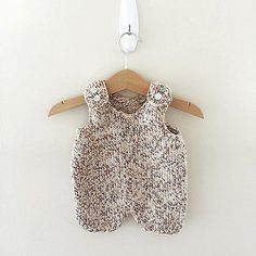 This cute knit baby romper is cute and playful, a great baby shower gift.