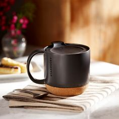 Starbucks® Cork Bottom Mug - Black, 12 fl oz. $12.95 at StarbucksStore.com Wow! A non-intrusive mug with a travel lid!