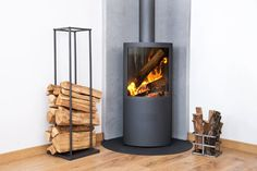 Modern Wood Burning Stove Tucked in Room Corner — Photo Remodeling Modern Wood Burning Stoves, Wood Burning Fires, Wood Stoves, Malm, Pellet Stoves For Sale, Corner Wood Stove, Concrete Bedroom, Logs For Sale, Bioethanol Fireplace